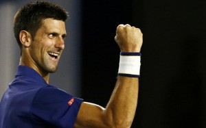 Serbia's Djokovic celebrates after winning his semi-final match against Switzerland's Federer at the Australian Open tennis tournament at Melbourne Park